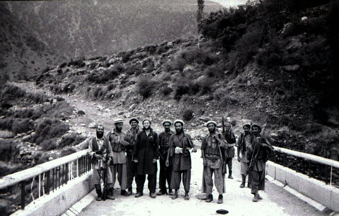 With Yunus Khalis mujahideeen on bridge near Bargam north of Asmar, August 1985 (4th from left).